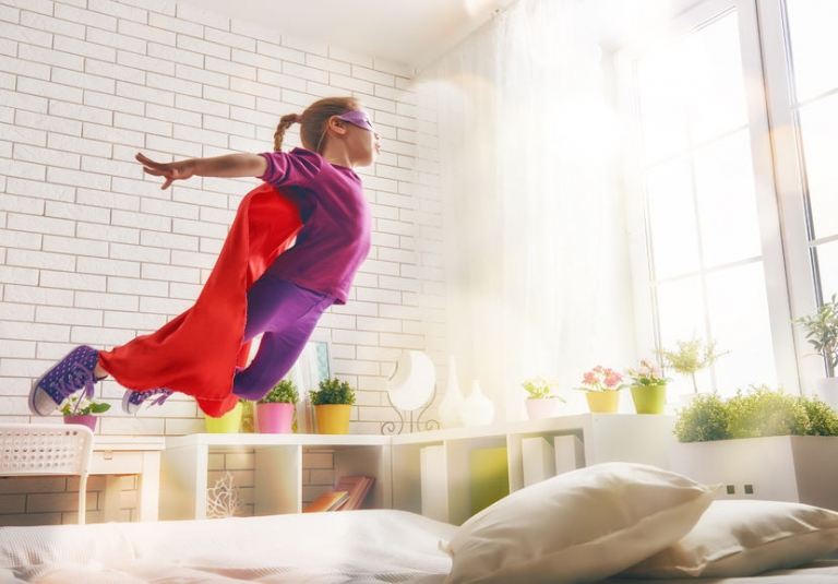 Kid jumping on the bed