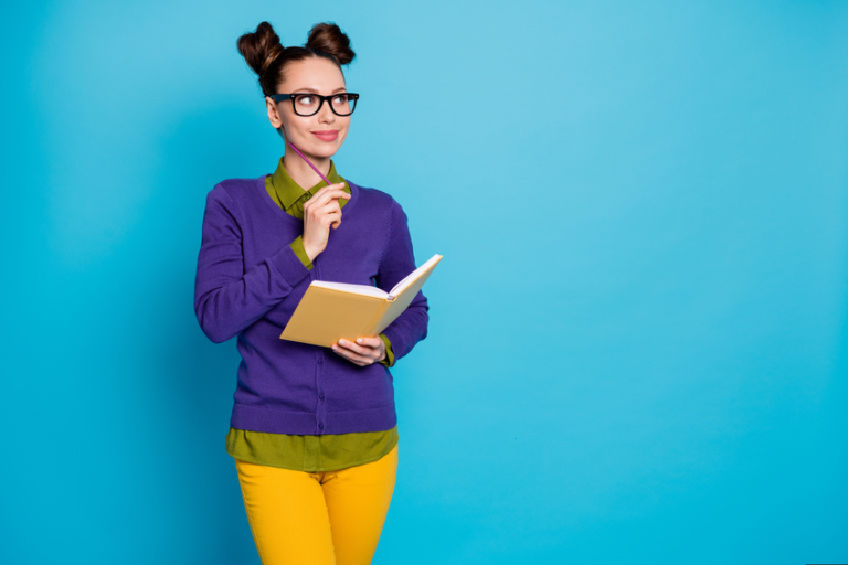 Woman writer wearing a colorful outfit and pondering the quesstion: what type of writer am I?